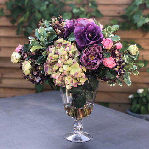 Dusky faux flower arrangement to buy or hire from Twilight Living where you can bring Twilight Tree magic home. From artificial trees to our amazing biophilia design products. Click to find out more.