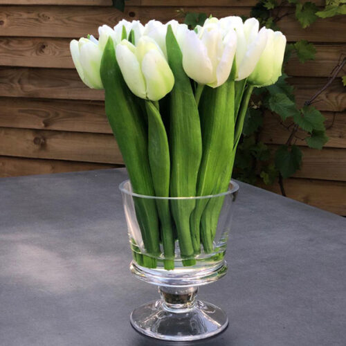 Faux white tulips flower arrangement in glass vase to buy or hire from Twilight Living where you can bring Twilight Tree magic home. From artificial trees to our amazing biophilia design products. Click to find out more.