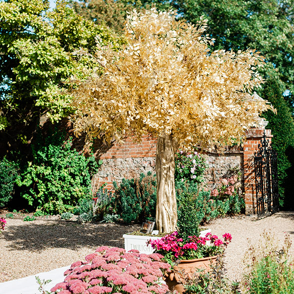 Hire large faux gold tree for outdoor events
