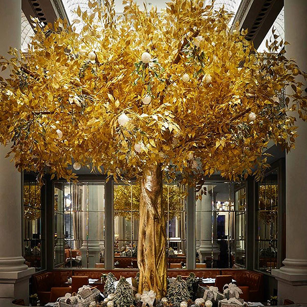 Hire large faux gold Christmas tree