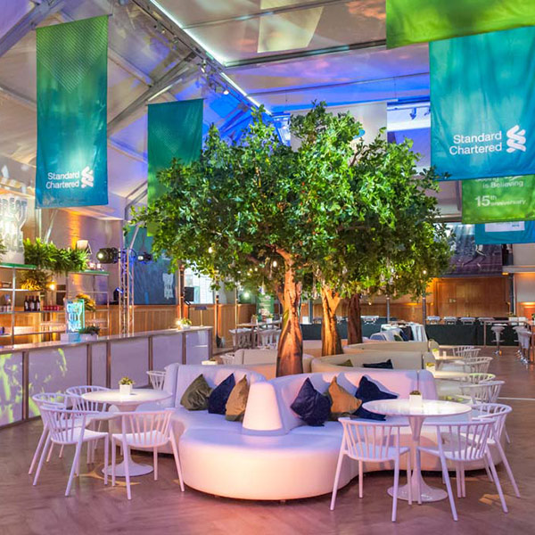 Hire large faux green trees for corporate events