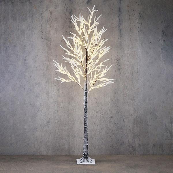 Large white flocked lit trees